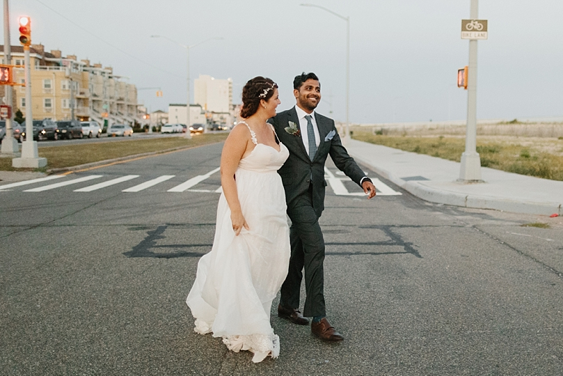 Bride and Groom Walking Across Street in Rockaway New York