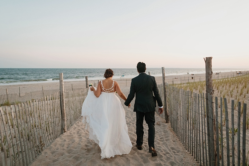 Married Couple Walks Towards Beach in Rockaway New York