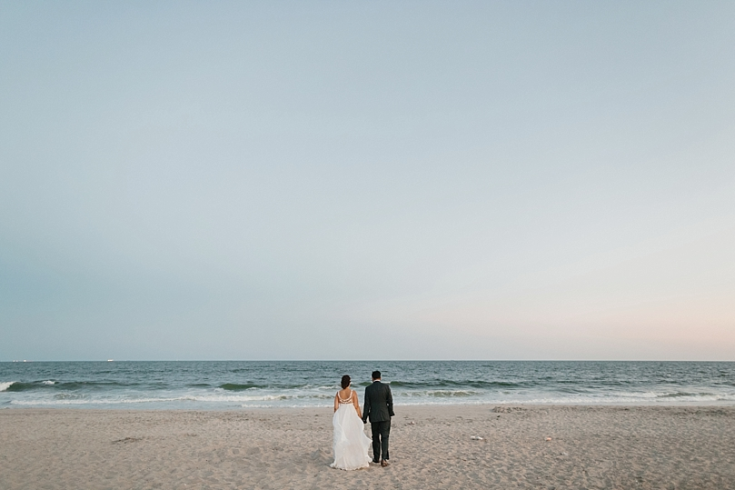 Married Couple Walks Towards Ocean in Rockaway New York