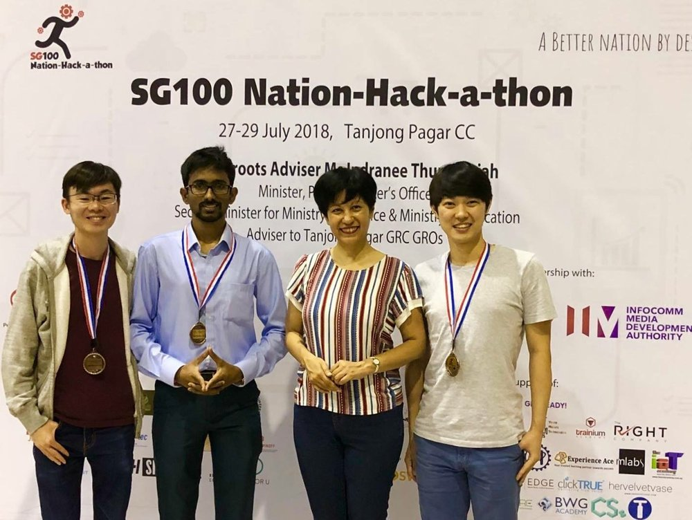 Pictured: Our team receiving medals from Ms. Indranee Thurai Rajah, a Minister in the Prime Minister's office and Singapore's Second Minister of Finance and Education (Yi Fan not pictured)