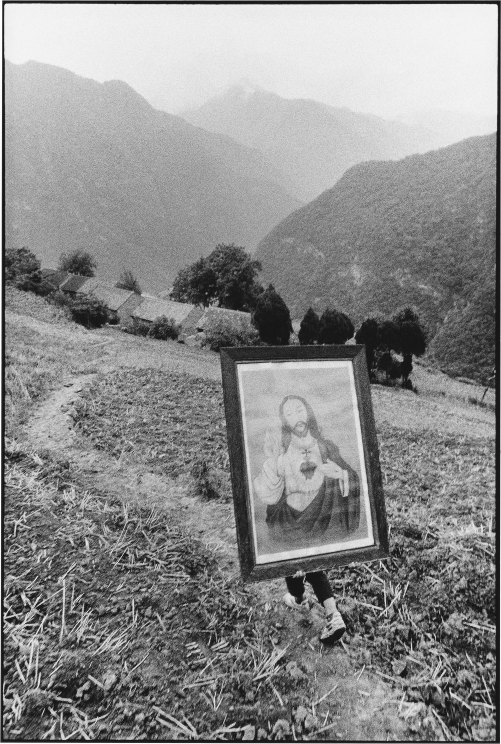 A Youth Carrying an Image of Jesus, Shaanxi, China