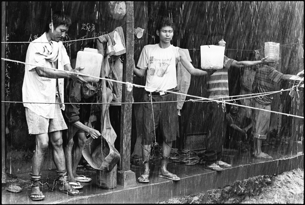 Prisoners Collecting Rain Water