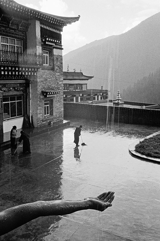 A monk collecting rain water, Sichuan