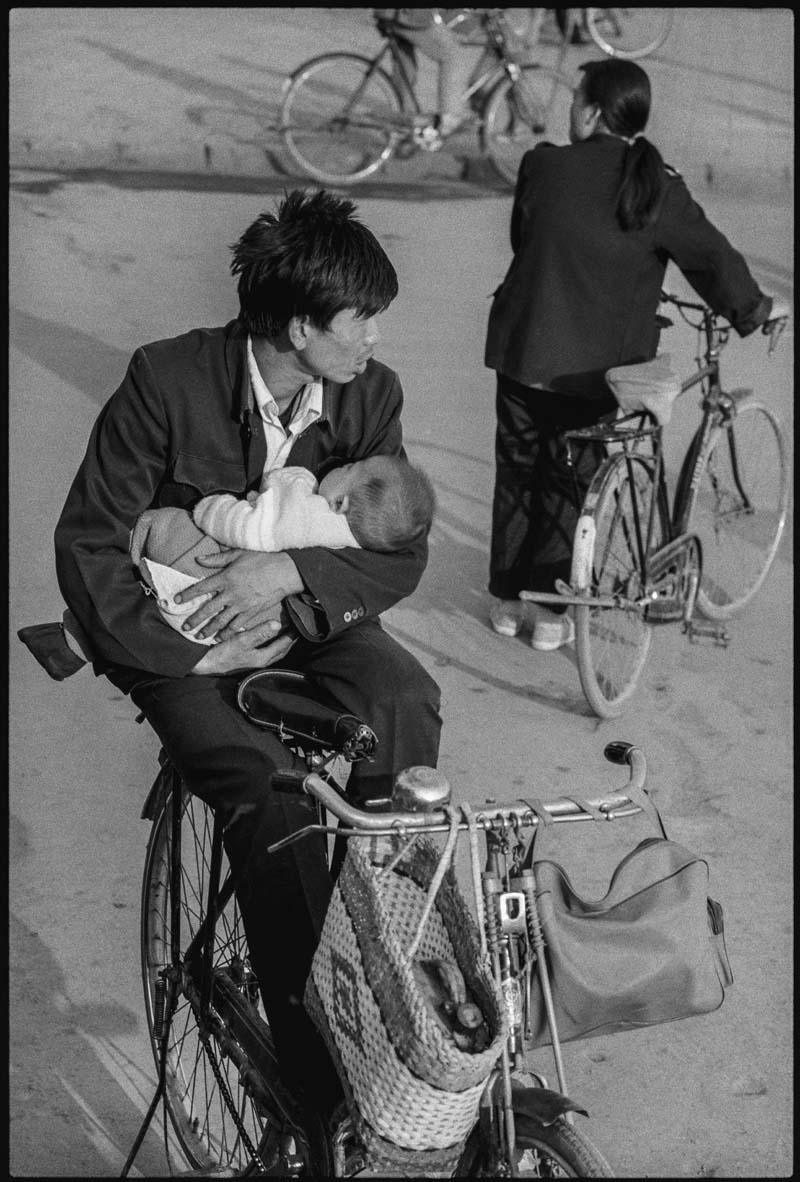 A Nurturing Father on a Bike