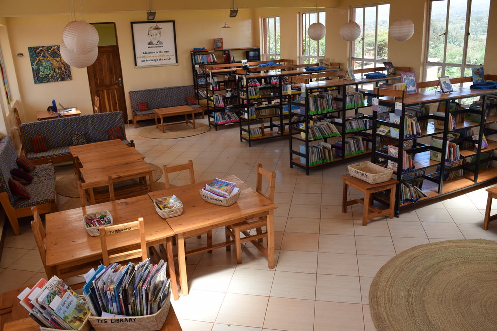Library   With the help of Tauck World of Giving, TEC was able to provide Tumaini Junior with a beautiful, well equipped library. We have books for every age level, as well as an activity center for students to engage in games and brainteasers to keep them actively engaged. When Tumaini Senior was built, we brought our more advanced books over and have continued to expand as the school does.