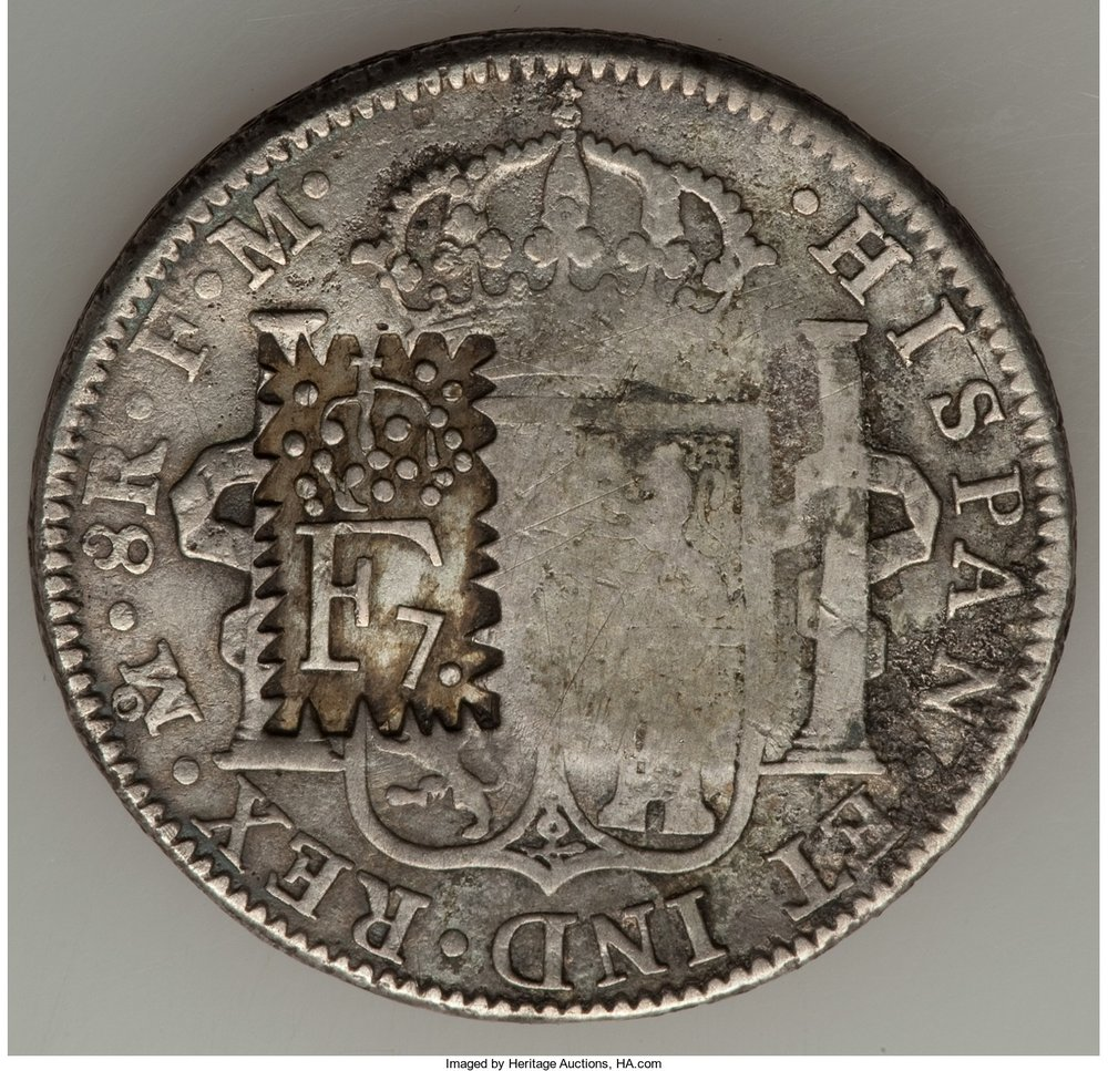 Sobresello F7 sobre moneda 8 reales Mexico.