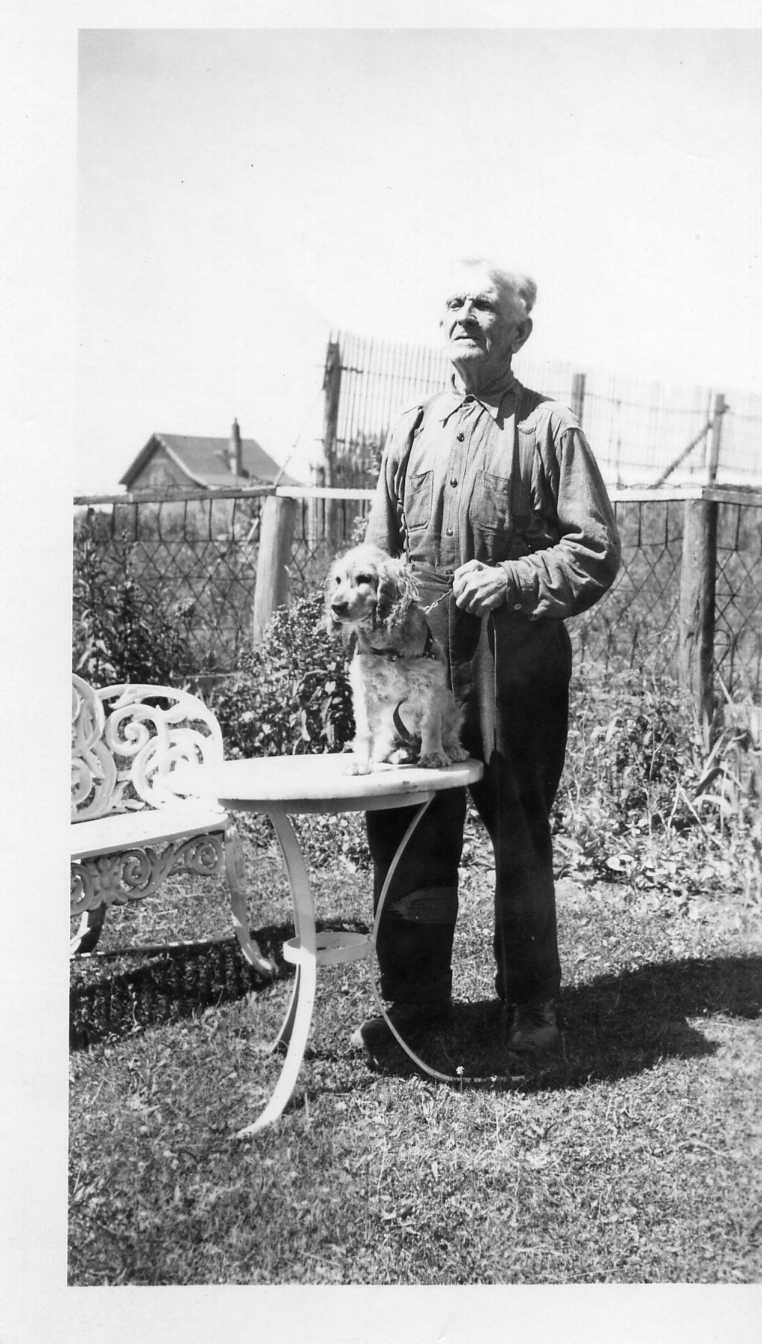 "Cornelius Kelly (1872-1950) and his cocker spaniel ""Judge"""