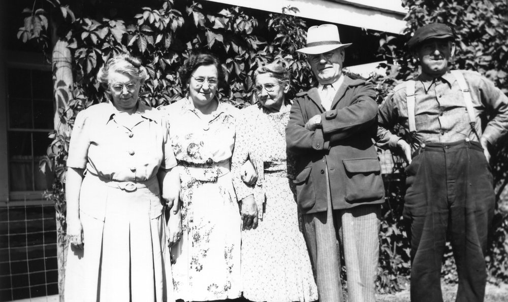 "Left to right: Mayme Hanley, Alma Ratz Hanley, Martha Zenner Muenzel, Peter McNamara, Albert ""Rabbit"" Zenner."
