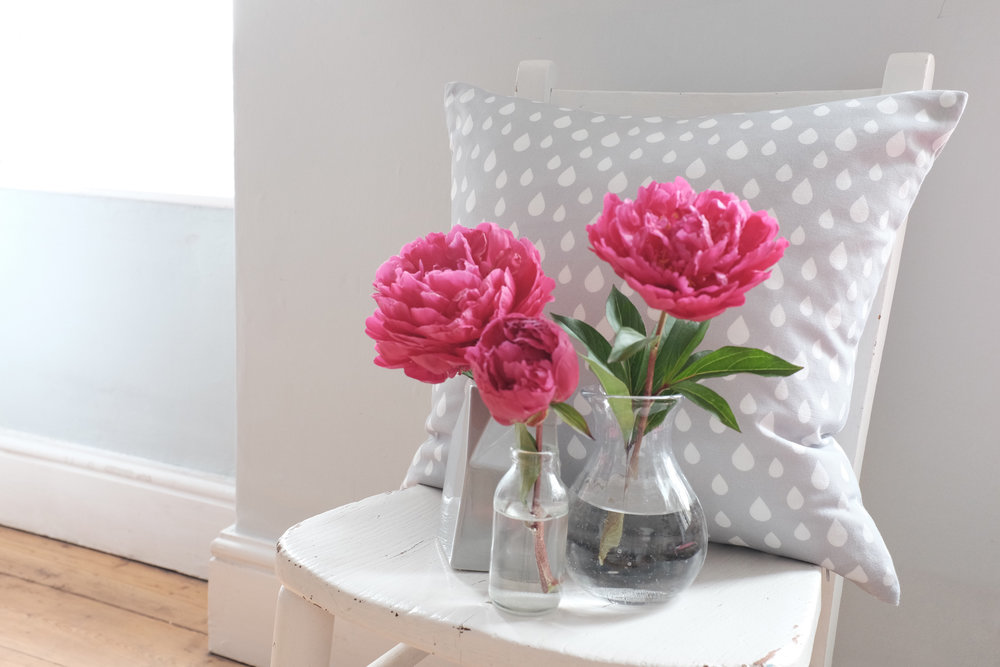 Raindrops cushion on chair with flowers.jpg