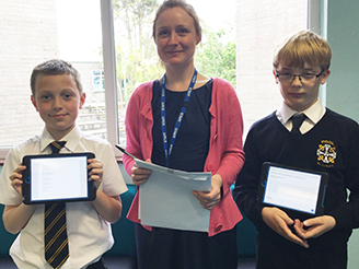 Luke Anderson, Year 7, Miss Humphreys, and Harry Kessell with poems to be read at the LorientInterceltic Festival