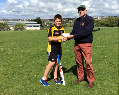 Roger Watson of the Rotary Club of Redruth presenting The Pool Academy U13 captainJarrod Hambly  with the cheque.
