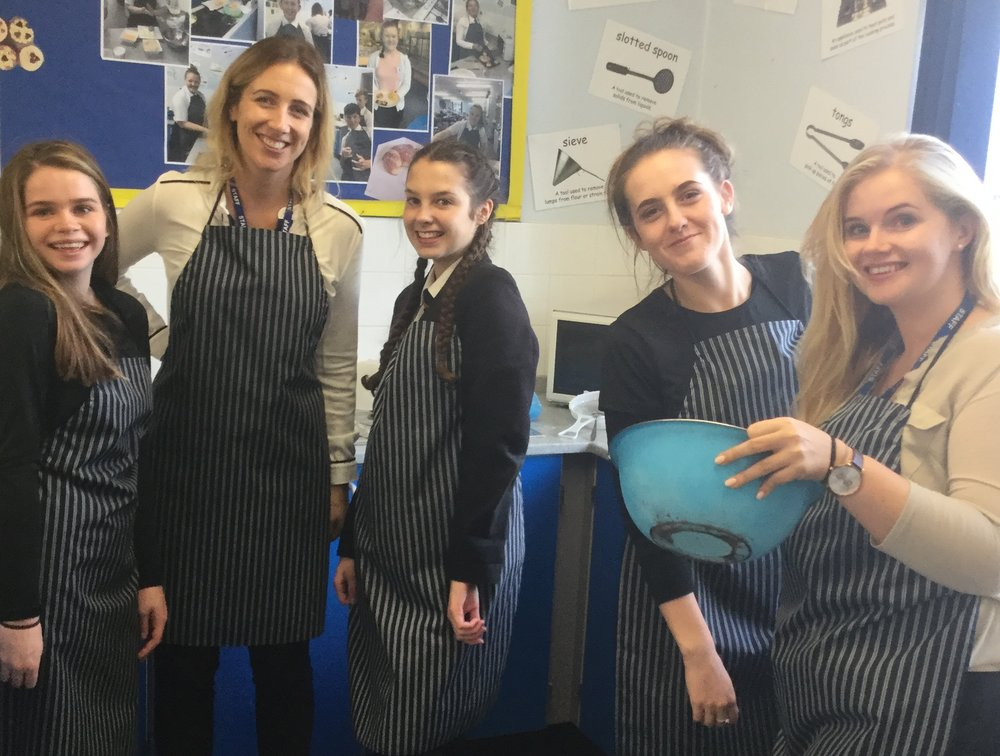 Staff and students baking for the sale.