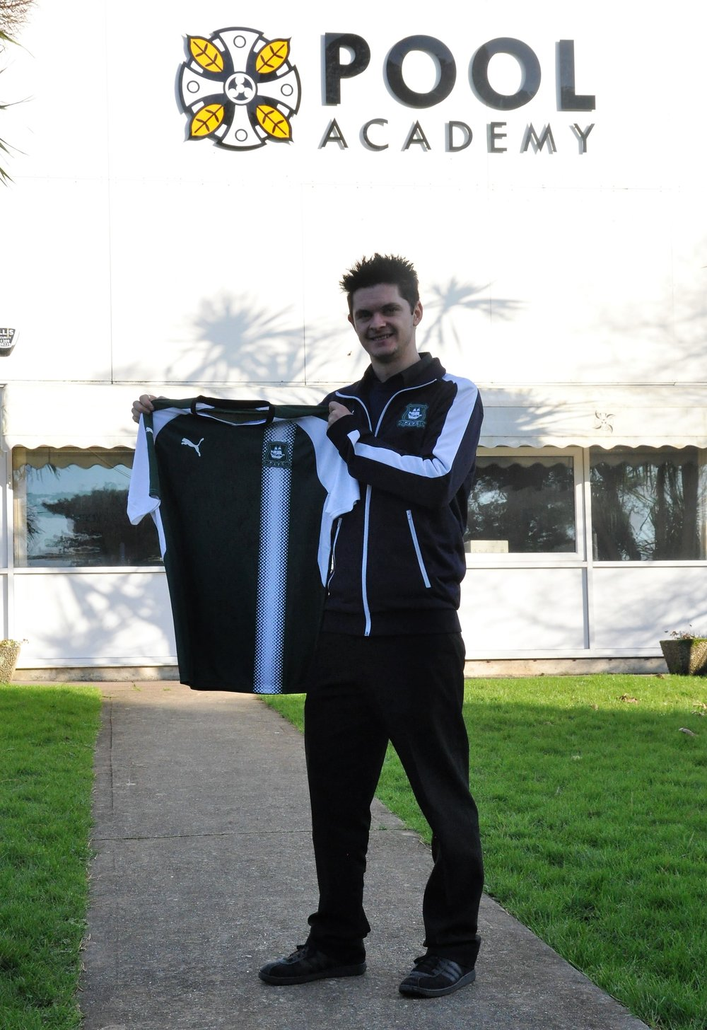 Photograph Caption: Mark Fuller with the shirt to be displayed at Pool Academy.