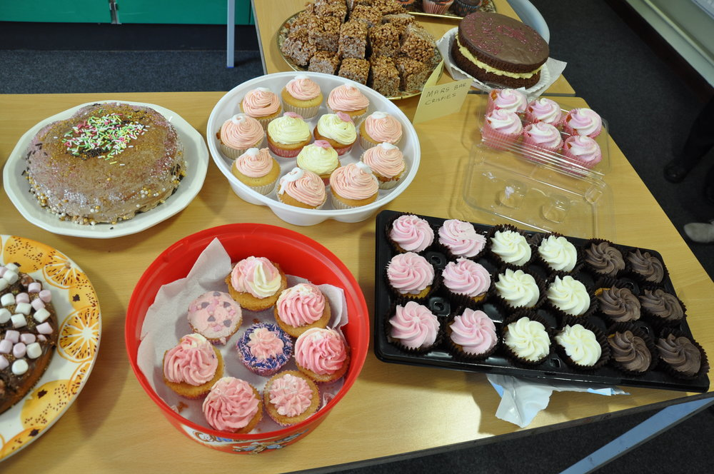 Tasty pink cakes baked for charity sale.