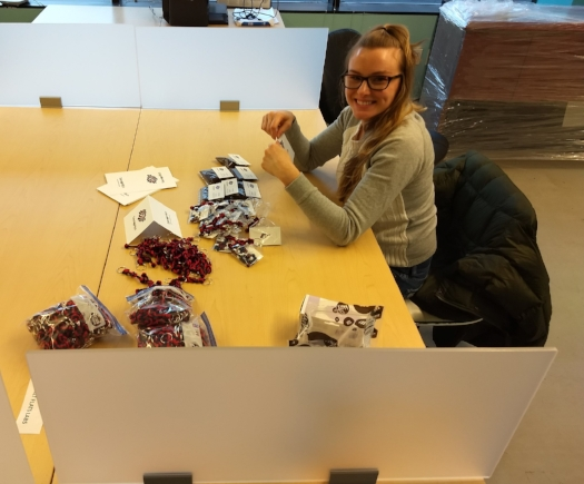 "Tara making M&M swag bags to join our custom made ""knot logo"" key chains and  Cooper's Coffee Co.  promo coffee satchels! YUM!"