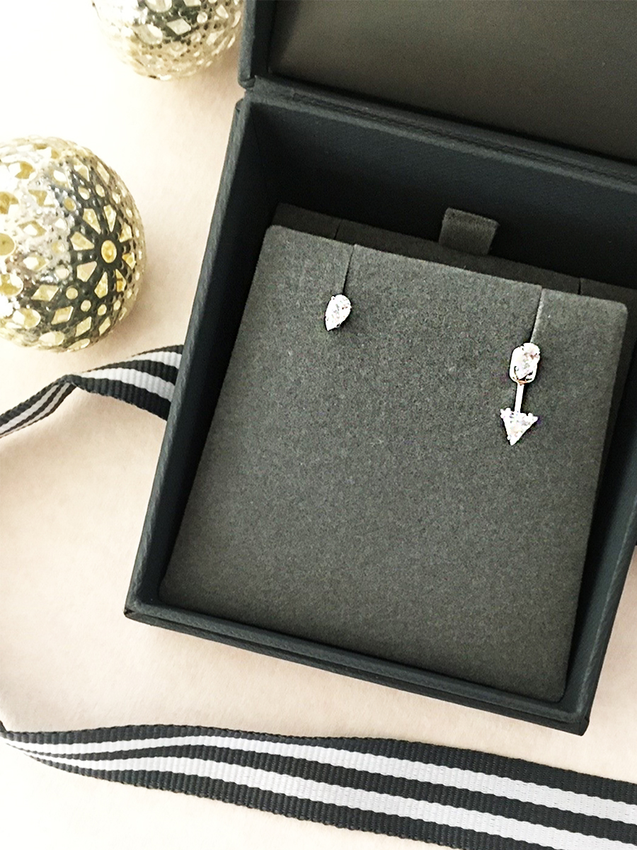Get the asymmetric look with these  Swarovski Attract Crystal Stud Earrings .