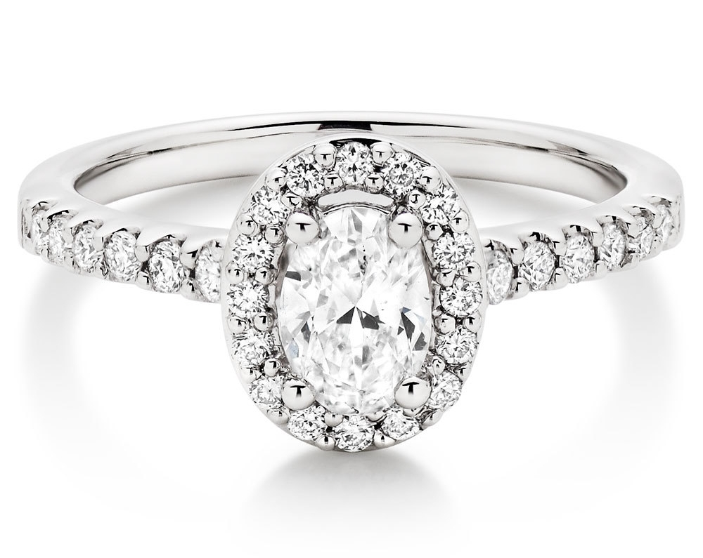 The ultimate in vintage glamour, our  Platinum Diamond Halo Ring  will take your breath away.