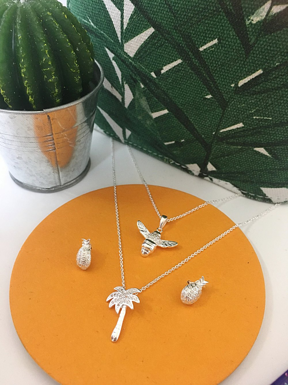 How cute are these?! Our Bee Pendant, Palm Tree Pendant and Bee Earrings.