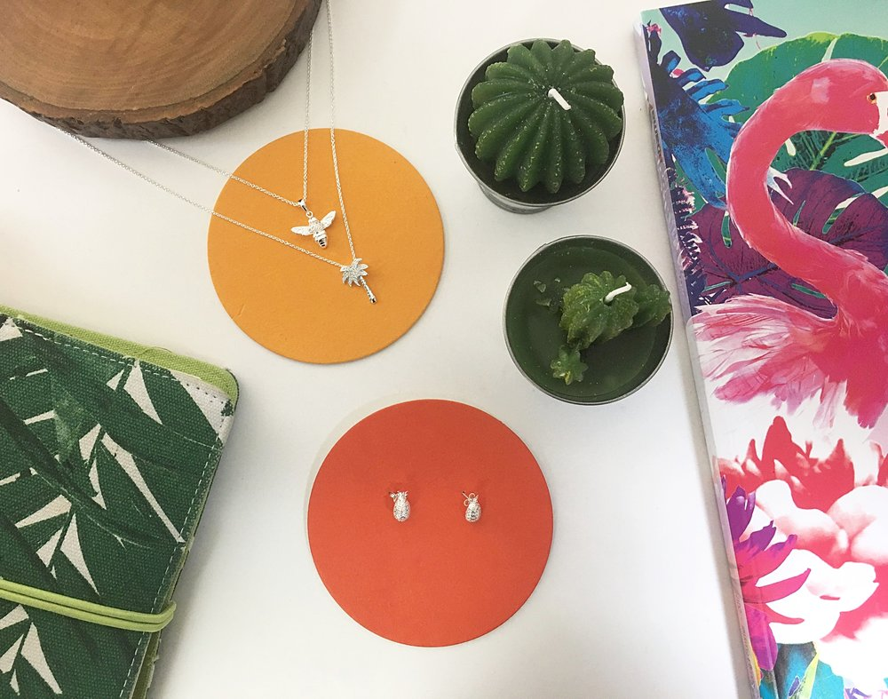 Our  Bee Pendant ,  Palm Tree Pendant  and  Pineapple Earrings  will bring sunshine to the everyday.