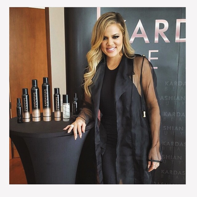 KARDASHIAN BEAUTY LAUNCH IN DUBAI Khloe Kardashian Wears PA5H Organza Trench Coat During The Krdashian Beauty Launch In Dubai. May 25, 2015