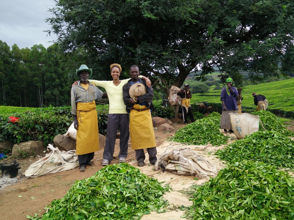 Swaady with tea farmers in Rwanda