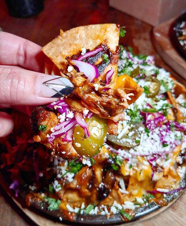 We'll be munching on our mole chicken nachos, wild mushroom tostadas, esquites, mezcal oysters, and whole suckling pig tacos all throughout our Day of the Dead party tomorrow night...and taking mezcal n' tequila breaks of course! 🌮🍹⁣⁣ ⁣⁣ Skip the line and get your tickets (in bio) now.⁣⁣ 🎟 ⁣⁣ 📸: @restaurantgroupie