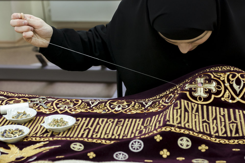 Nun sewing gems on liturgical cloth, Ekaterinburg, November 2009