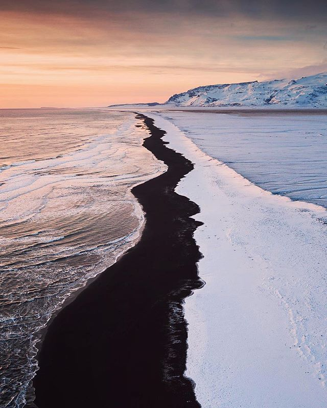 The Land of Contrasts - The few hours of light available during the winter months in Iceland provide a stunning glow over a majestic landscape. This shot was taken looking up the coastline of Jökulsárlón black sand beach, more famously known as the Diamond Beach. . . . . . #dronephotography #visualseduction #dronelife #earthfocus #stayandwander #travelstoke #natgeotravel #landscape_captures #droneshot #visualsofearth #dronegear #globalcapture #justgoshoot #lensbible #djiphantom4 #passionpassport #worldprime #igtones #creatorgrams #droneaddict #abstractphotography #global_shotz #dronefly #aerialphoto #drone #exploretocreate #dronesdaily #everydayiceland #exploreiceland #guidetoiceland