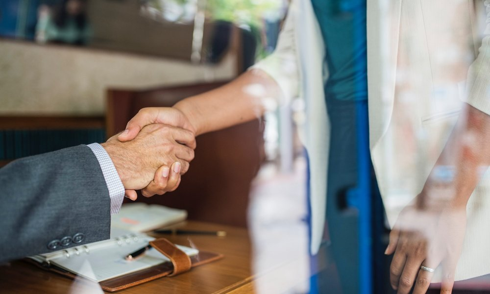 Client Shaking Hands with a Software Developer