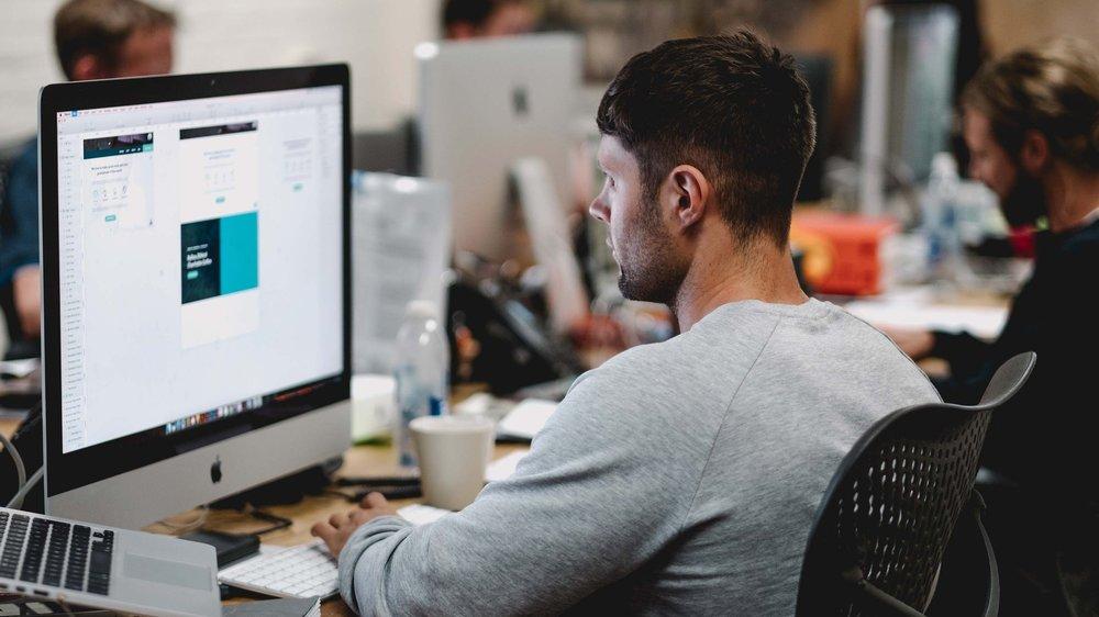 Male Offshore Software Developer Working on Desktop Computer