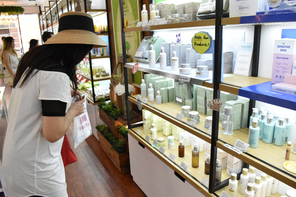 Our owner looking at some Face Shop products