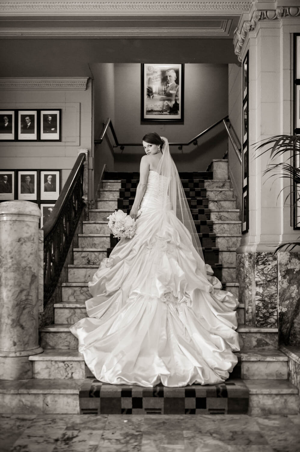 arctic-club-bride-long-dress-stairs.jpg