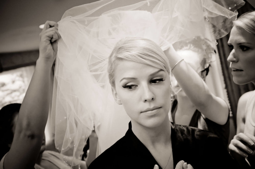 pensive-bride-getting-dressed.jpg