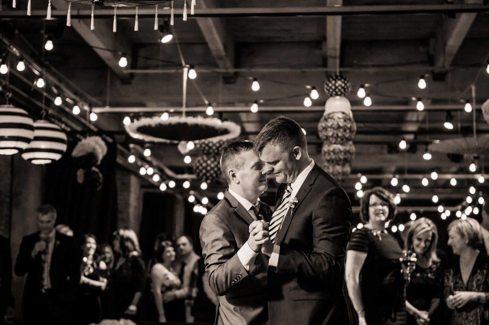 two-men-married-dancing-melrose-market-seattle.jpg