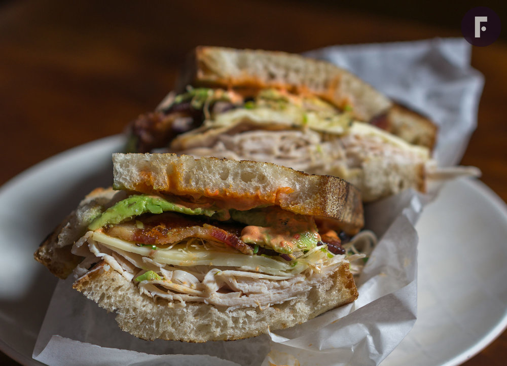 Corner Farmacy - Look at those wonderful turkey club layers... bacon, avocado, cheese, sprouts and quality turkey