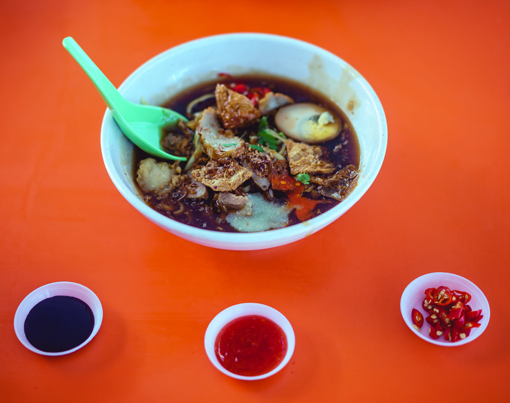 Bedok Hawker Centre  - Rich & hearty duck noodle dish.