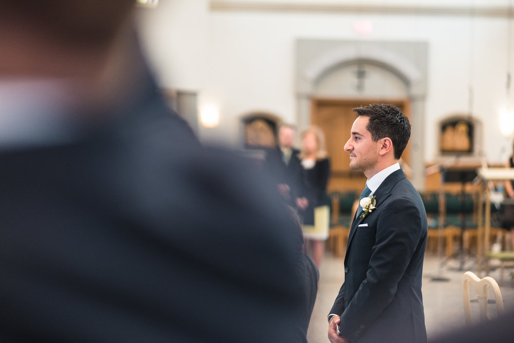 Groom waiting for bride at ceremony