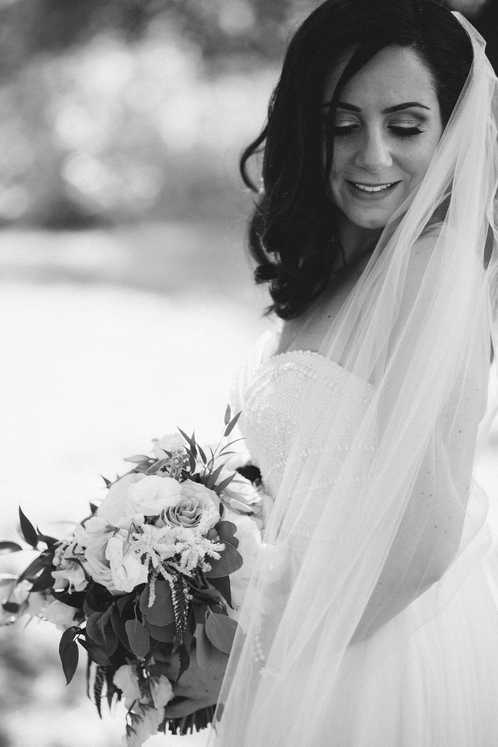 Bride and bouquet at the bark