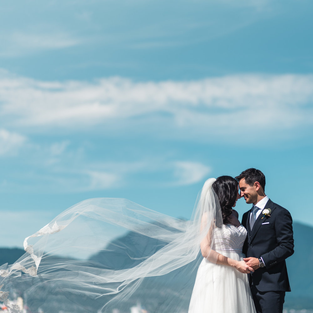 Bride and Groom at the beach with mountains