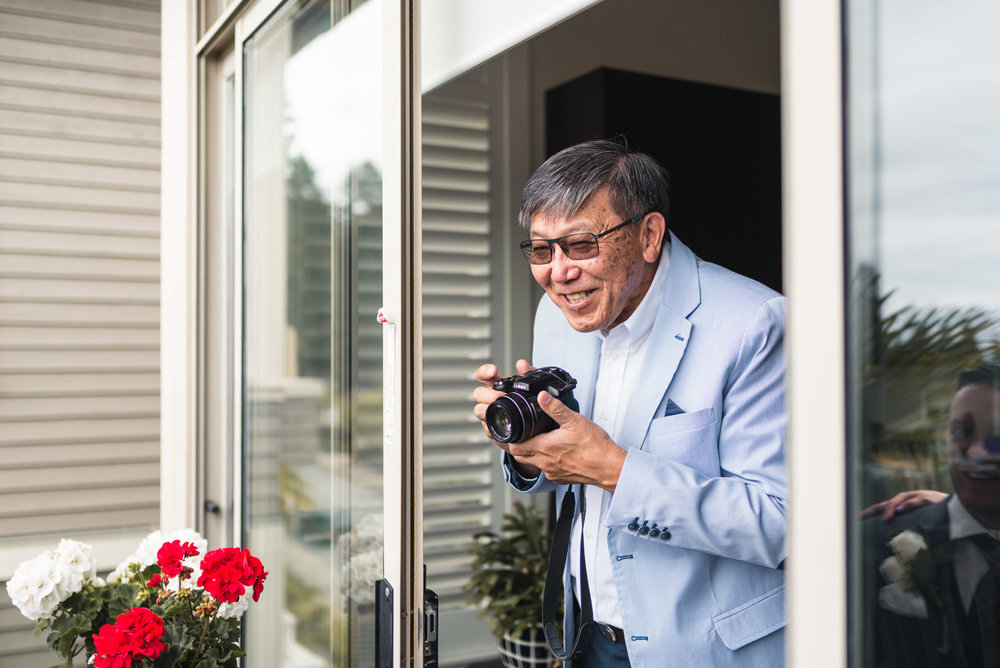 Guest with camera at Groom's house