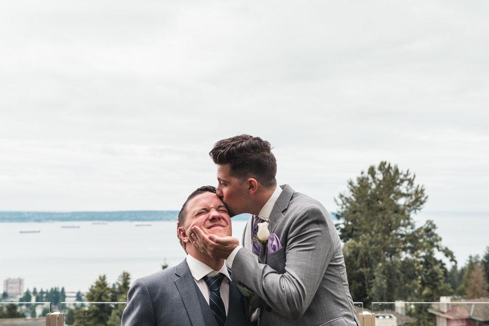 Groomsman kissing the Groom
