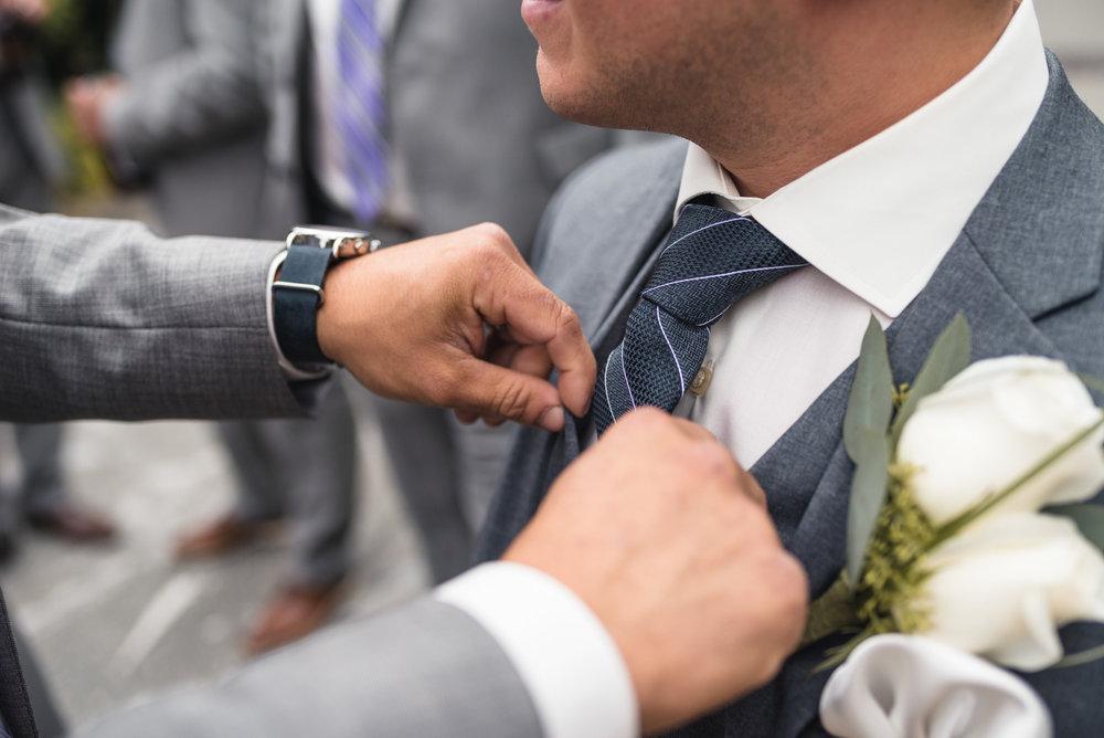 Adjusting the Groom's tie