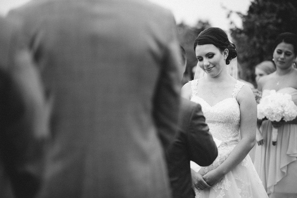 Groom giving his wedding vows to Bride