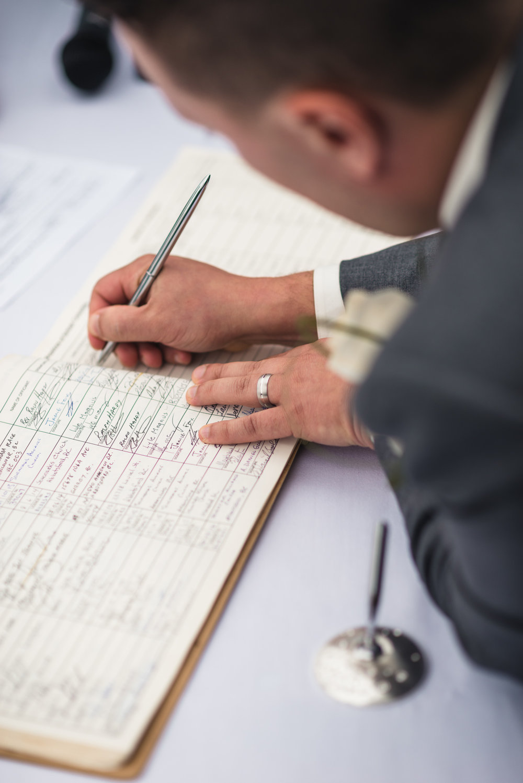 Groom signing marriage lisence