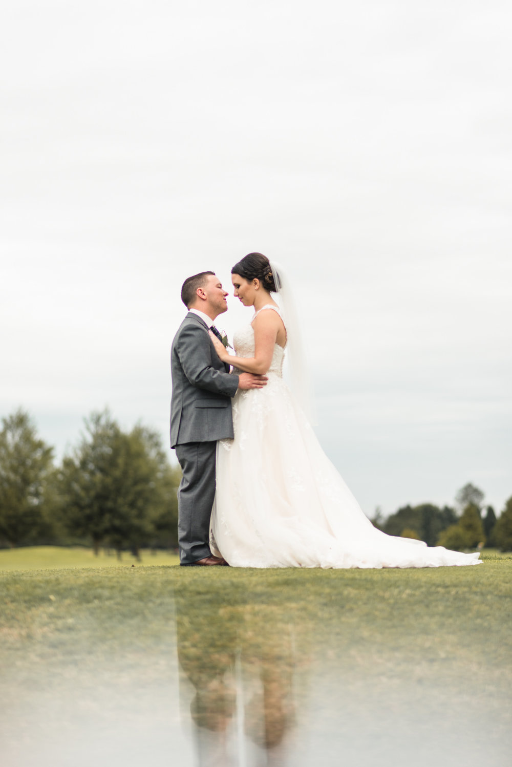 Bride and Groom kissing with reflection
