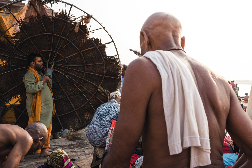 Man with umbrella in Varanasi