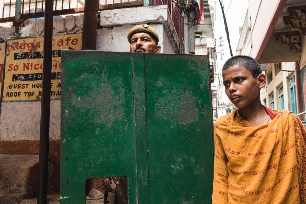 Police officer and boy in Varanasi