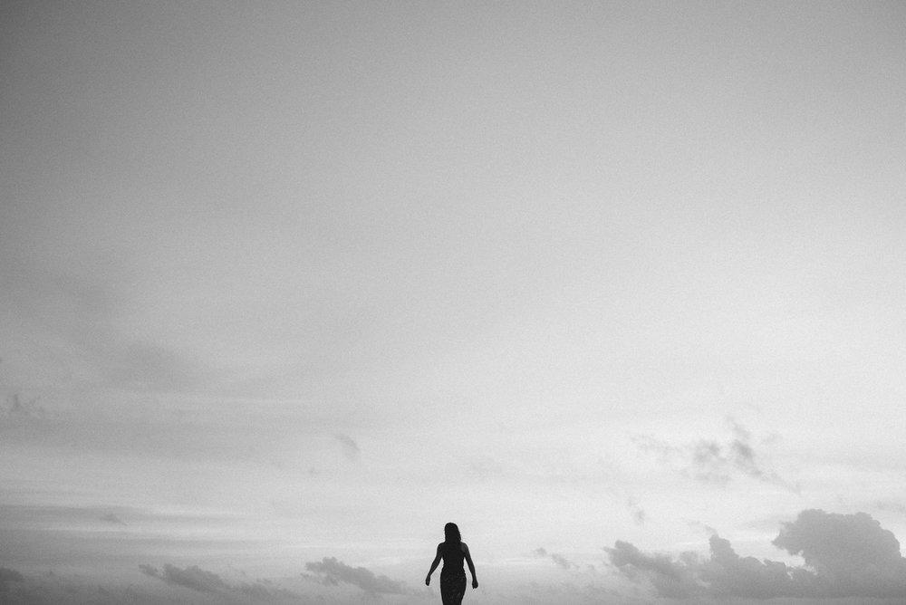 Woman walks on Marari Beach