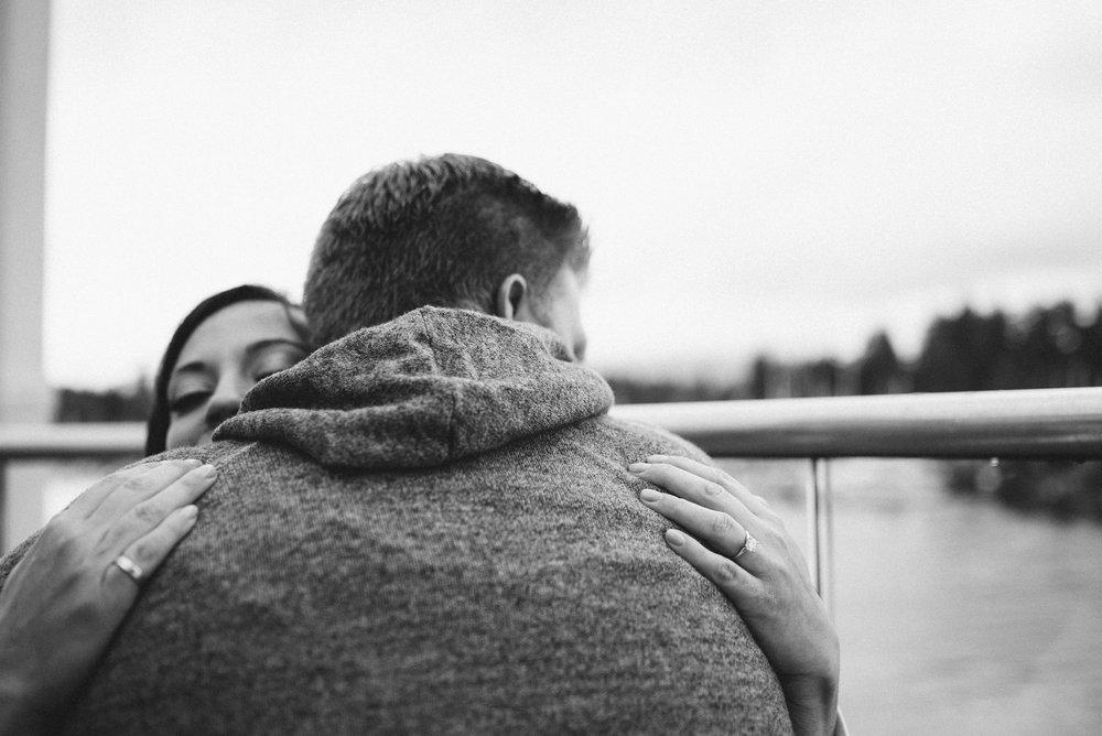Couple hug on patio
