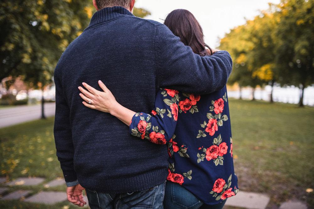 Couple hugs in park
